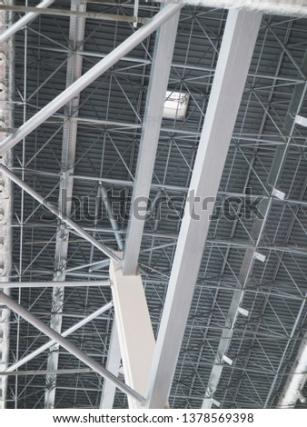 Stadium ventilation system and fire extinguishing system between the steel roof supports standing on concrete beams. Complex multi-system engineering structures. #1378569398