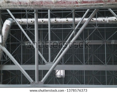 Stadium ventilation system and fire extinguishing system between the steel roof supports standing on concrete beams. Complex multi-system engineering structures. #1378576373
