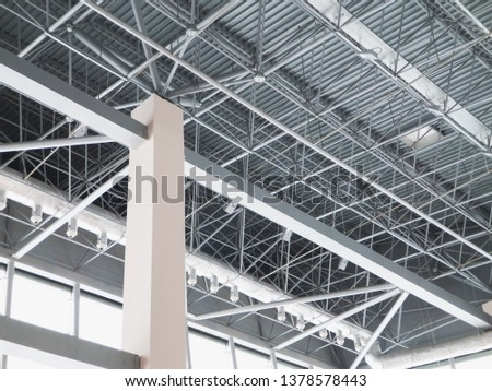 Stadium ventilation system and fire extinguishing system between the steel roof supports standing on concrete beams. Complex multi-system engineering structures. #1378578443