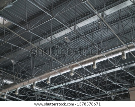 Stadium ventilation system and fire extinguishing system between the steel roof supports standing on concrete beams. Complex multi-system engineering structures. #1378578671