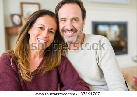Beautiful romantic couple sitting together on the floor at home #1378617071