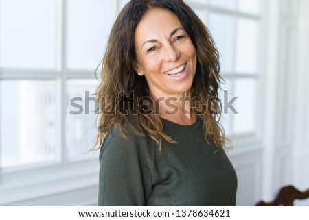 Beautiful middle age woman at home smiling cheerful #1378634621