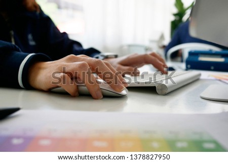 businesswomen using laptop analyzing marketing strategy with statistic graph on the table. #1378827950