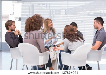 Group therapy session sitting in a circle #137896091