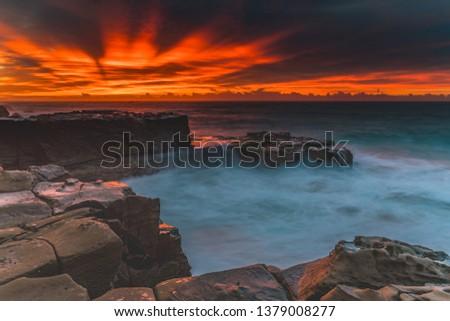 Colourful Coastal Seascape from Headland - Capturing the sunrise from North Avoca Beach on the Central Coast, NSW, Australia. #1379008277