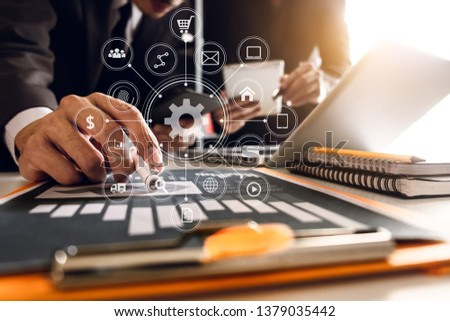 Working team meeting concept, business using laptop and smart phone and digital tablet computer with digital marketing media  in virtual icon network diagram office in morning light  #1379035442