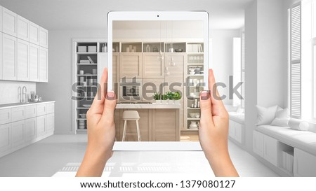 Hands holding tablet showing modern white and wooden kitchen, total blank project background, augmented reality concept, application to simulate furniture and interior design products, 3d illustration