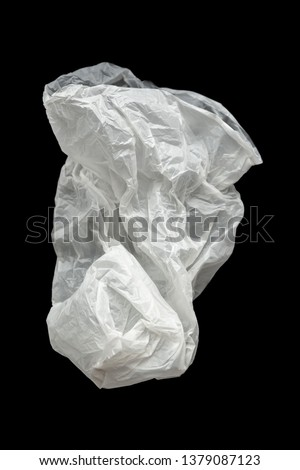 Plastic bag on a black background, isolate. Used plastic bag for recycling. Recycling of plastic waste into pellets as a business. #1379087123