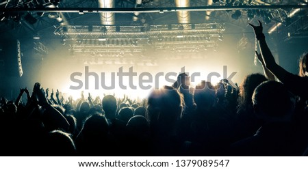 Party night in a concert hall, people silhouettes are visible #1379089547
