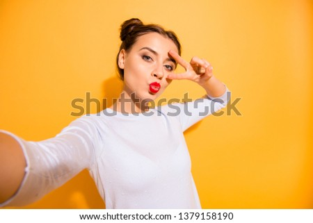 Close up photo of fabulous beautiful sensual attractive person people isolated making photo on her cell phone v-sign sharing air kiss internet wearing light woolen clothing on bright background #1379158190