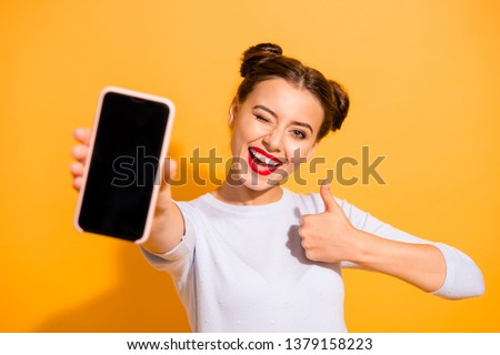 Close up photo of charming beautiful attractive lady taking photo offering suggesting advising product raising her thumb up dressed up white sweater isolated over vivid background #1379158223