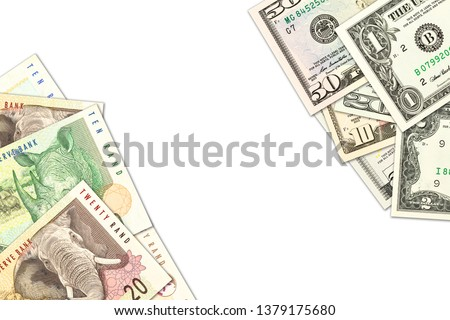 some south african rand banknotes and us-dollar banknotes with copyspace indicating trade relations #1379175680