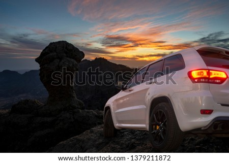 SUV driving on mountain off-roads #1379211872
