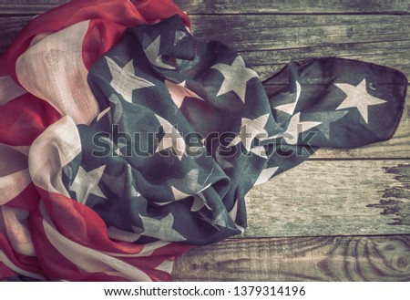 National Patriotic symbols. American flag on an old wooden background.The concept of patriotism and celebration #1379314196