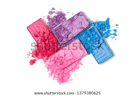 A broken pink, red and blue eye shadow make up palette isolated on a white background. Top view, flat lay. Copy space for your text #1379380625