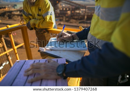 Miner supervisor sign of approval working at height working permit prior to performing high risk work on construction mine site, Perth, Australia  #1379407268