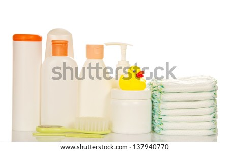 Baby care objects. Olive, shampoo, diapers isolated on white #137940770