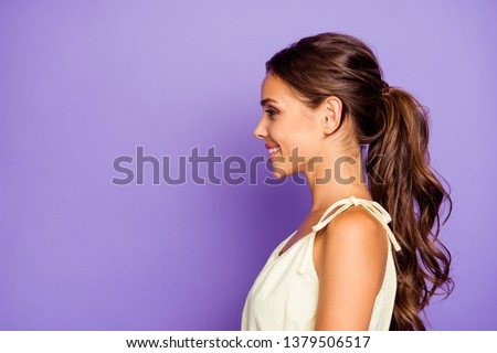 Close-up profile side view portrait of nice adorable well-groomed attractive stunning lovable fascinating magnificent winsome content cheerful cheery wavy-haired girl isolated over violet background #1379506517