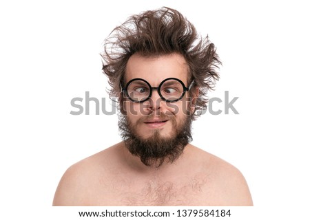 Crazy bearded Happy Man with funny Haircut in eye Glasses making grimace - Silly face. Cheerful and silly naked guy, isolated on white background. #1379584184