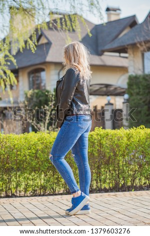 Fashionable woman in glasses wear leather jacket and jeans, casual trend #1379603276