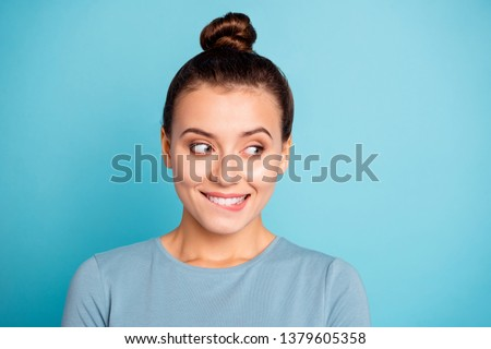 Close up photo beautiful funky amazing she her lady cute look side empty space bite lip give me candies cookies yummy hungry expression wear casual sweater pullover isolated blue bright background #1379605358