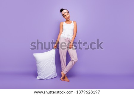Full length body size photo beautiful she her lady look empty space wondered thoughtful hold hand arm pillow barefoot wear sleeping mask pants tank-top pajamas isolated violet purple background #1379628197