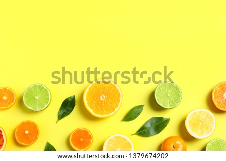 Different citrus fruits and leaves on color background, flat lay. Space for text #1379674202