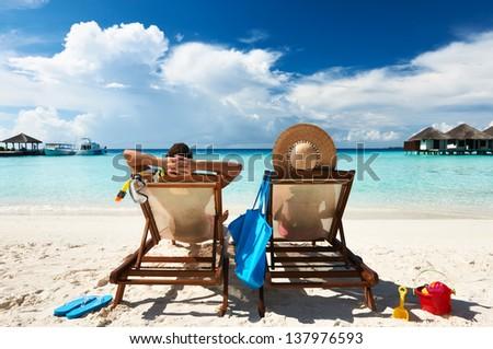 Couple on a tropical beach at Maldives #137976593