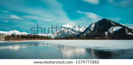 Panorama of Mount Rundle mountain peak with blue sky reflecting in Vermilion Lakes at Banff national park, Alberta Canada #1379771882