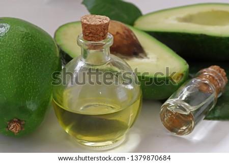Avocado and avocado oil on a white background. #1379870684