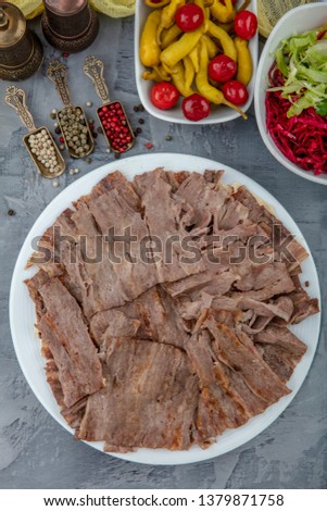 Turkish Doner Kebab on plate. Arabic traditional doner with pita bread / lavash. Protein nutrition, clean eating, diet concept. Turkish, greek or middle eastern style doner kebab food restaurant. #1379871758