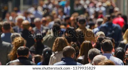 Crowd of people walking street Royalty-Free Stock Photo #1379935829