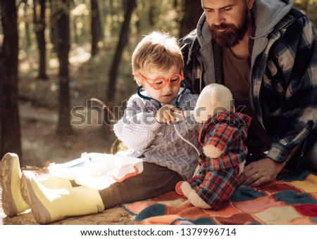 Father and child son in autumn park having fun and laughing. Happy family, father and baby son playing and laughing on autumn walk. #1379996714