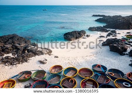 Be island ( small island, Bo Bai island ) with local colorful  basket boats  at  Ly Son island, Quang Ngai Province, Viet Nam Royalty-Free Stock Photo #1380016595