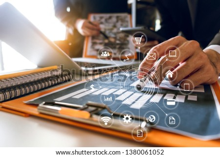 Business team partnership meeting concept. Business hand using laptop, tablet and smartphone  in office. Digital marketing media mobile app in virtual icon screen in morning light #1380061052