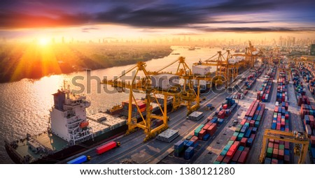 Aerial panoramic view of Logistics and transportation of Container Cargo ship and Cargo plane with working crane bridge in shipyard at sunrise, logistic import export and transport industry background #1380121280