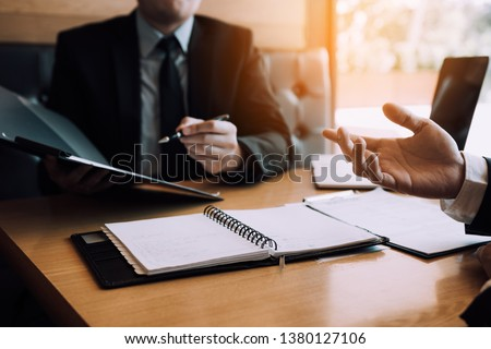 Men employee are describing the employment history of the employer about his work experience. Royalty-Free Stock Photo #1380127106