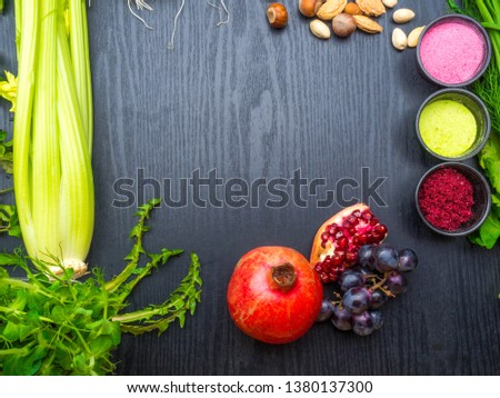 various Super foods, berry powder - strawberry, raspberry, nuts, pomegranate, grape, dandelion and selery, broccolion a wooden background, copy space #1380137300