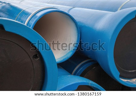 Stack of new blue pipes (tubes). Fluid conveyance. Pipeline construction. #1380167159