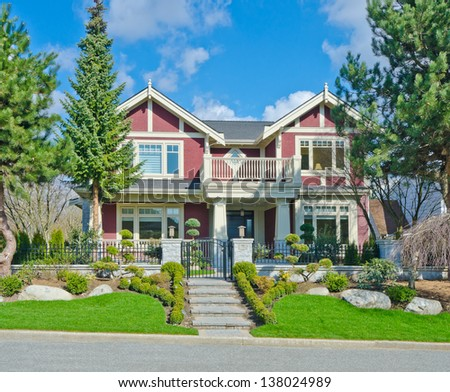 Big custom made luxury house with nicely decorated and trimmed front yard in the suburbs of Vancouver, Canada. #138024989