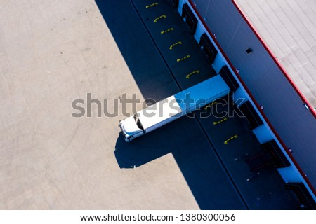 Distribution logistics building parking lot. Aerial View #1380300056