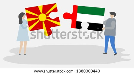 Couple holding two puzzles pieces with Macedonian and Emirian flags. Macedonia and United Arab Emirates national symbols together. #1380300440
