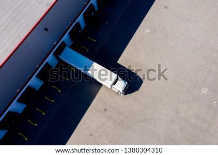 Distribution logistics building parking lot. Aerial View #1380304310