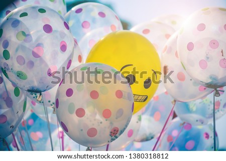 Colourful transparent polka dot and heart shape balloons that merchants stand for sale at festivals or congratulations for graduation. #1380318812