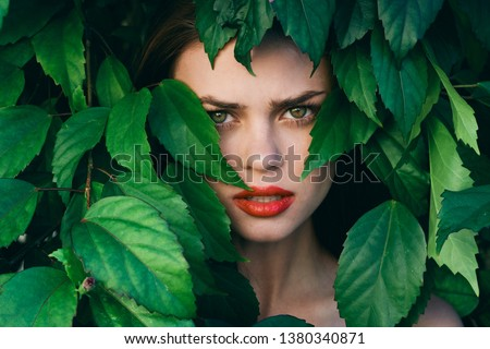 beautiful woman with make up on face green shrub nature #1380340871