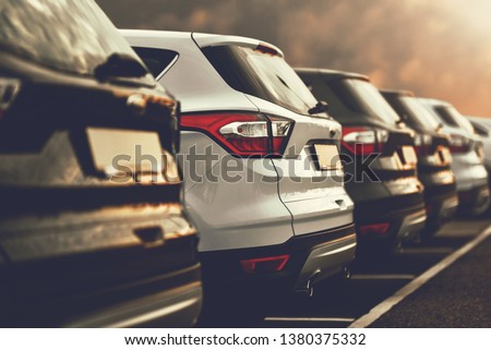 electric cars SUVs parked in row on dealership parking #1380375332