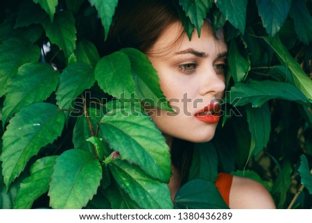 woman with make up on her face Exotic green shrub nature model #1380436289
