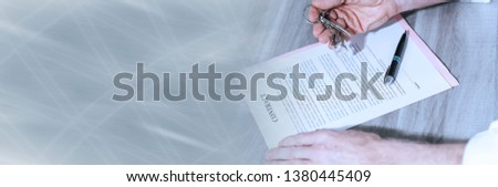 Signature of a real estate contract (lorem ipsum text used). panoramic banner #1380445409