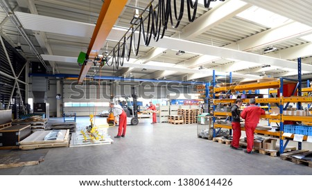 employees in a metalworking company - interior with machines in the industrial hall  #1380614426