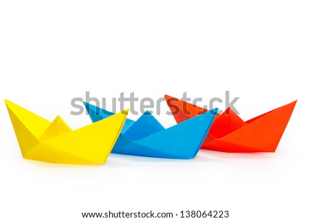 Tree colored paper ships on a white background #138064223